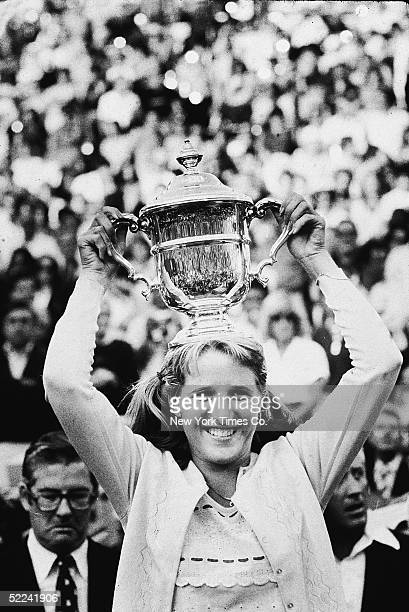 16yearold American tennis phenom Tracy Austin smiles as she holds her trophy overhead after winning the US Open at the West Side Tennis Club Forest...