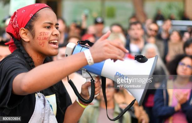 A 16yearold girl who only have her name as Lori speaks to protesters at a rally against racism in Oakland California on August 12 2017 Protesters...