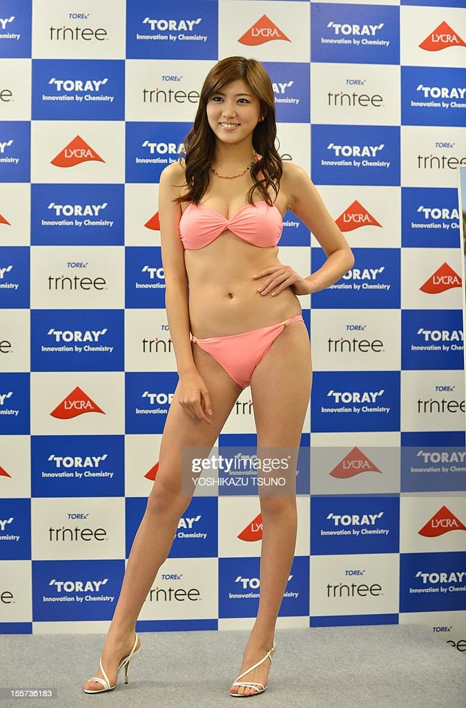 16-year-old high school student Nami Iwasaki displays a bikini for the next season of Japanese apparel giant Toray as the company announced the new swimsuit campaign girl at Toray's headquarters in Tokyo on November 8, 2012. AFP PHOTO / Yoshikazu TSUNO