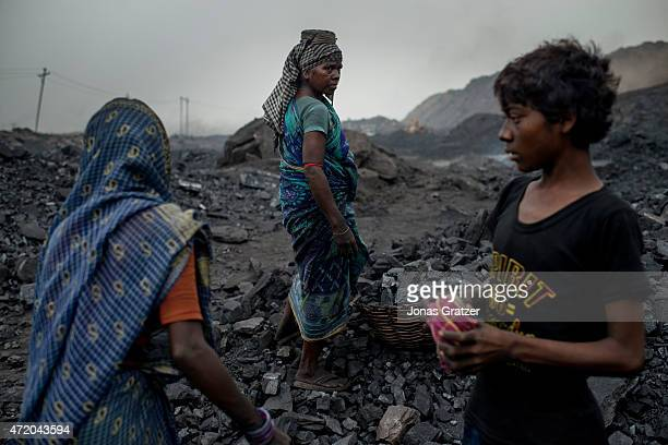 16yearold MD Kahn with his older colleagues at the Jharia coal mine Jharia in India's eastern Jharkand state is literally in flames This is due to...