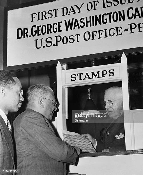 1/7/1948Philadelphia PA Postmaster Joseph F Gallagher sells the first sheet of George Washington Carver commemorative stamps to Judge Herbert E...