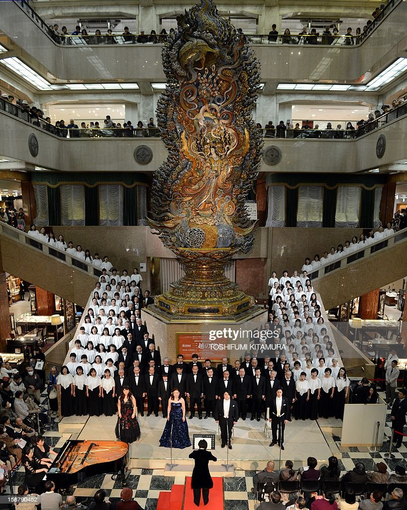 A 178-member choir group sings Ludwig van Beethoven's Symphony No. 9 at a department store in central Tokyo on December 29, 2012. The 29th annual New Year's concert is held to attract year-end shoppers to the store.