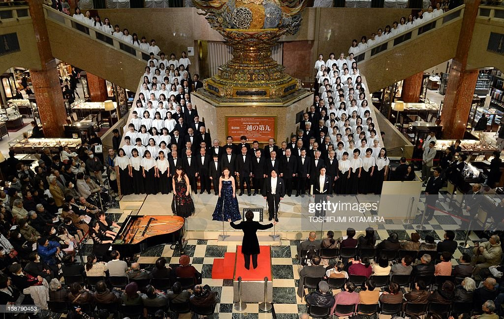A 178-member choir group sings Ludwig van Beethoven's Symphony No. 9 at a department store in central Tokyo on December 29, 2012. The 29th annual New Year's concert is held to attract year-end shoppers to the store. AFP PHOTO / TOSHIFUMI KITAMURA