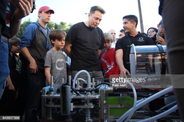 Elon Musk examines a student team's pod on January 29 2017 To accelerate the development of a functional Hyperloop prototype a high speed...