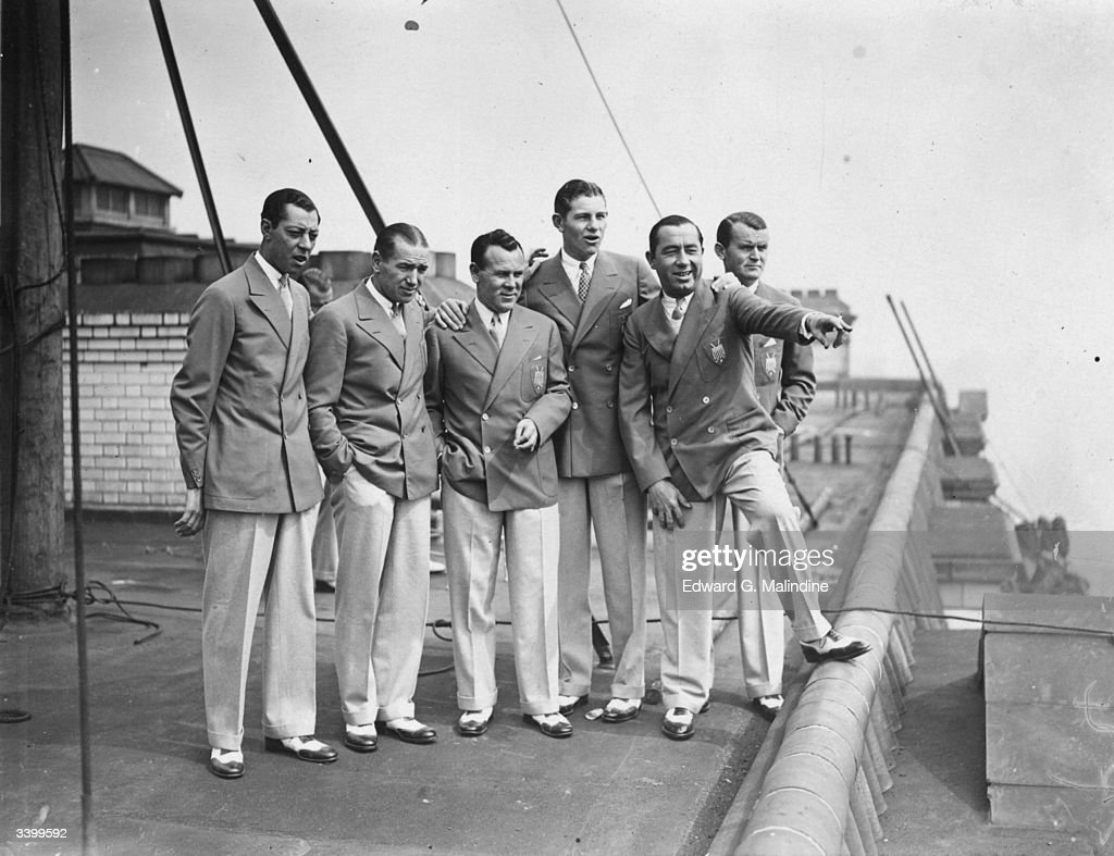 US golfer and Ryder Cup Team captain Walter Hagen points out various landmarks to his Ryder Cup teammates on the roof of the Savoy Hotel London