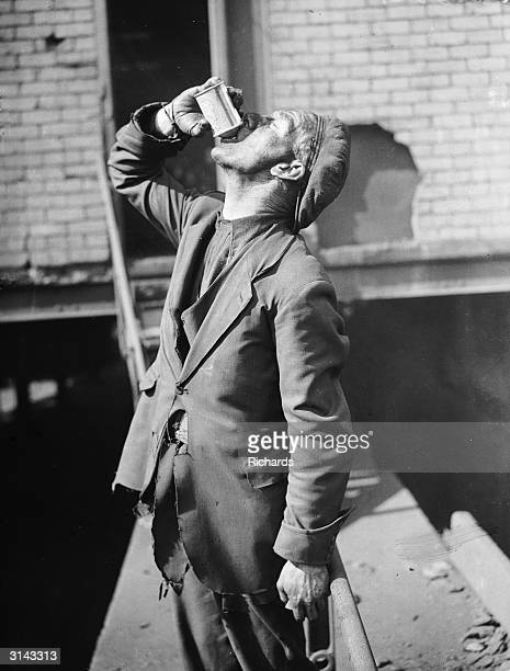 A miner at Rose Heyworth colliery in South Wales drinking a can of beer to celebrate the wedding of R D Firth the son of the mine owner Sir William...
