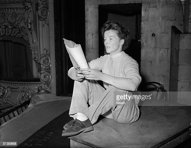 Katharine Hepburn rehearsing her lines for her role as Epifania in George Bernard Shaw's 'The Millionairess' at the Apollo Theatre London