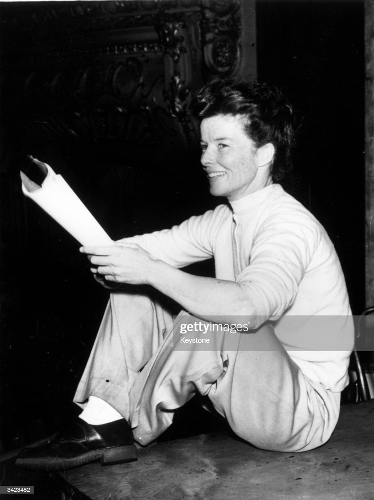 US actress <a gi-track='captionPersonalityLinkClicked' href=/galleries/search?phrase=Katharine+Hepburn&family=editorial&specificpeople=203012 ng-click='$event.stopPropagation()'>Katharine Hepburn</a> (1907 - 2003) relaxing after a rehearsal of Bernard Shaw's 'The Millionairess' at the Apollo Theatre, London. She is playing the part of Epifania.