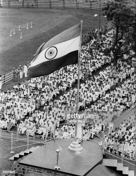 Indian prime minister Pandit Jawaharlal Nehru addresses the crowd in Delhi on the occasion of India's 14th Independence day Above him flies the...