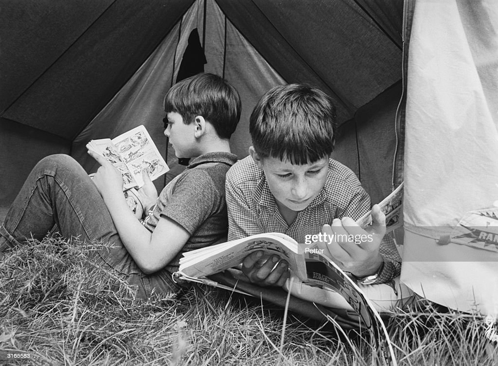 They may be attending a summer camp run by the National Association for Gifted Children, but these two boys enjoy reading comic books just like other kids their age.