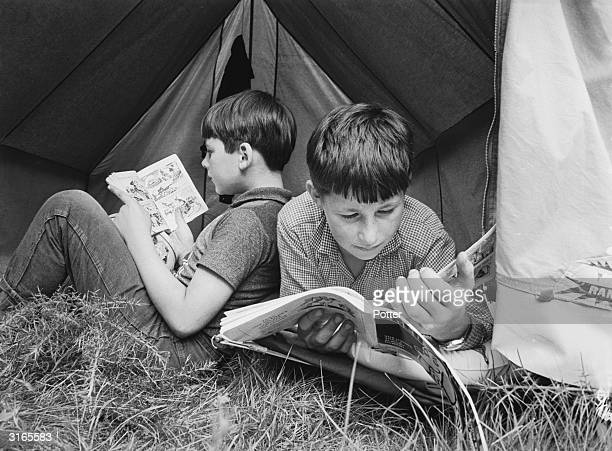 They may be attending a summer camp run by the National Association for Gifted Children but these two boys enjoy reading comic books just like other...