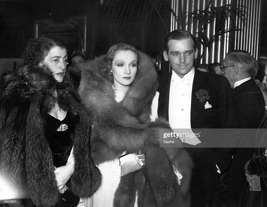 Germanborn US actress Marlene Dietrich attends the premiere of her latest film 'The Garden of Allah' in Leicester Square London in the company of...