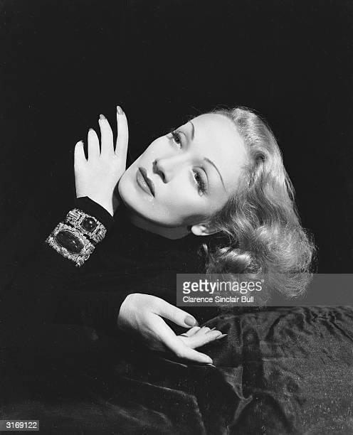 Germanborn actress Marlene Dietrich wearing a jewelencrusted bracelet
