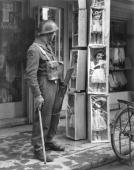 A British soldier of the Royal Norfolk regiment looks at dolls outside a shop in Nicosia