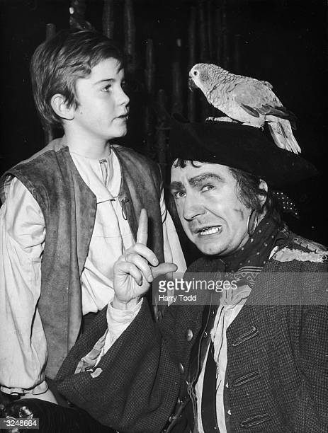 Fergus McClelland as Jim Hawkins and Peter Bayliss as Long John Silver in a production of 'Treasure Island' at the Mermaid Theatre in London On...