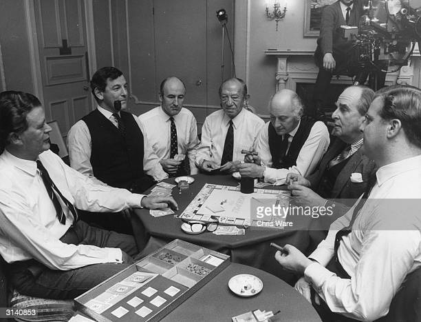 A party of celebrities and business tycoons gather together at Brown's Hotel in London for a game of Monopoly to be televised on BBC2's 'Money...