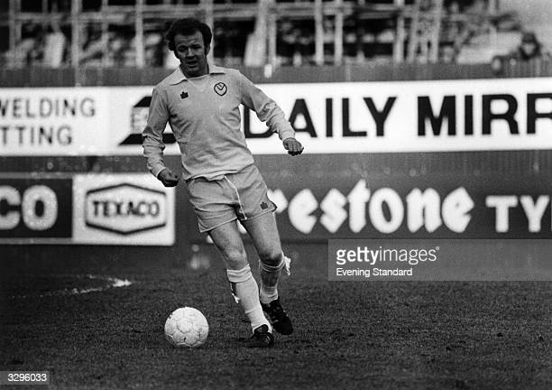 Leeds United football player Billy Bremner in action on the football pitch