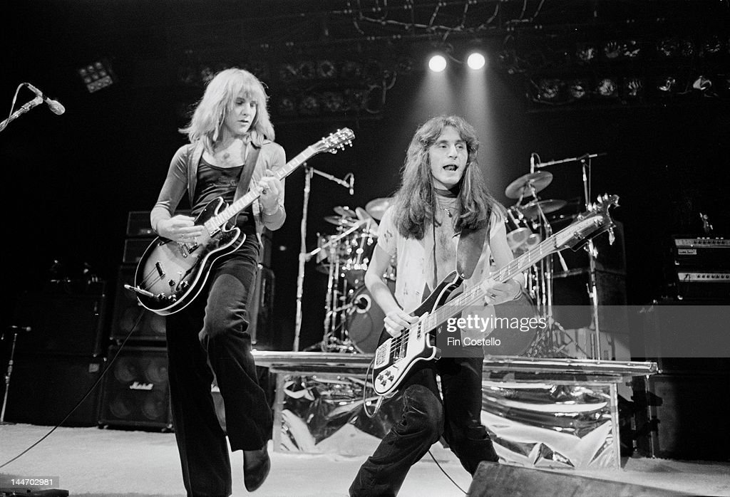 Guitarist Alex Lifeson and bassist Geddy Lee from Canadian progressive rock band Rush perform live on stage at the Public Auditorium in Cleveland...