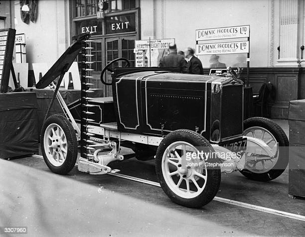 A tractor made from outofdate cars converted for mowing haymaking and cultivating operations on display at the Exhibition of Inventions at the Royal...