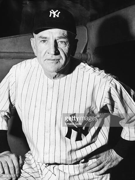 Portrait of New York Yankee baseball manager Casey Stengel in uniform standing in the dugout at Yankee stadium Bronx New York City His ball club he...