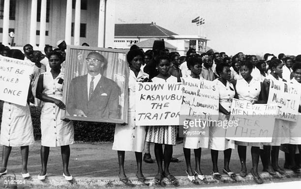 A group of women in Accra Ghana during a mourning parade for Patrice Lumumba the murdered former Premier of the Congo The slogans read 'Mobutu and...