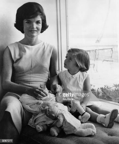 Jacqueline Kennedy wife of US President John F Kennedy and daughter Caroline relax together at home
