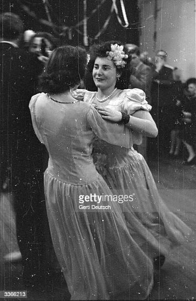 Young women dancing during a party at a Cecil House one of a series of lodging houses which are run by a charity formed by the British journalist Mrs...