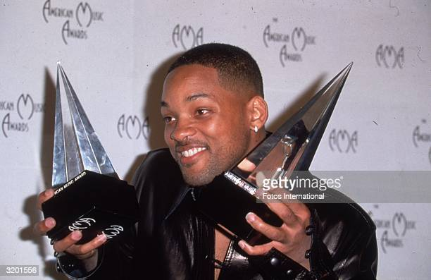 American actor and rap singer Will Smith at the American Music Awards displaying his two awards one for 'Favorite Male Artist' and the other for...