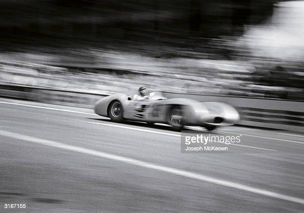 Argentinian racer Juan Manuel Fangio chalks up a win for the Mercedes team at the French Grand Prix in Reims Original Publication Picture Post 7209...