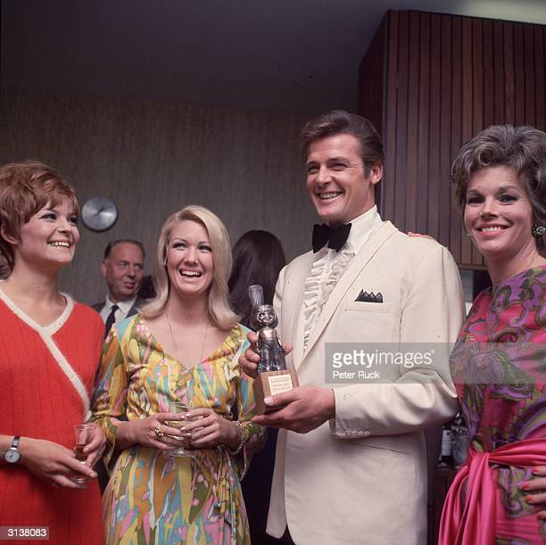 English film star Roger Moore well known for his roles as James Bond and the Saint accepting an award