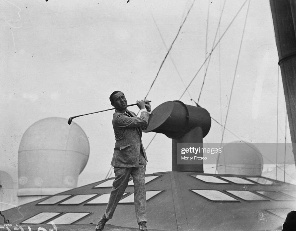 American golfer Walter Hagen gets in some practice on the deck of the Mauretania on the sea journey from the USA to the Open Golf Championships at...