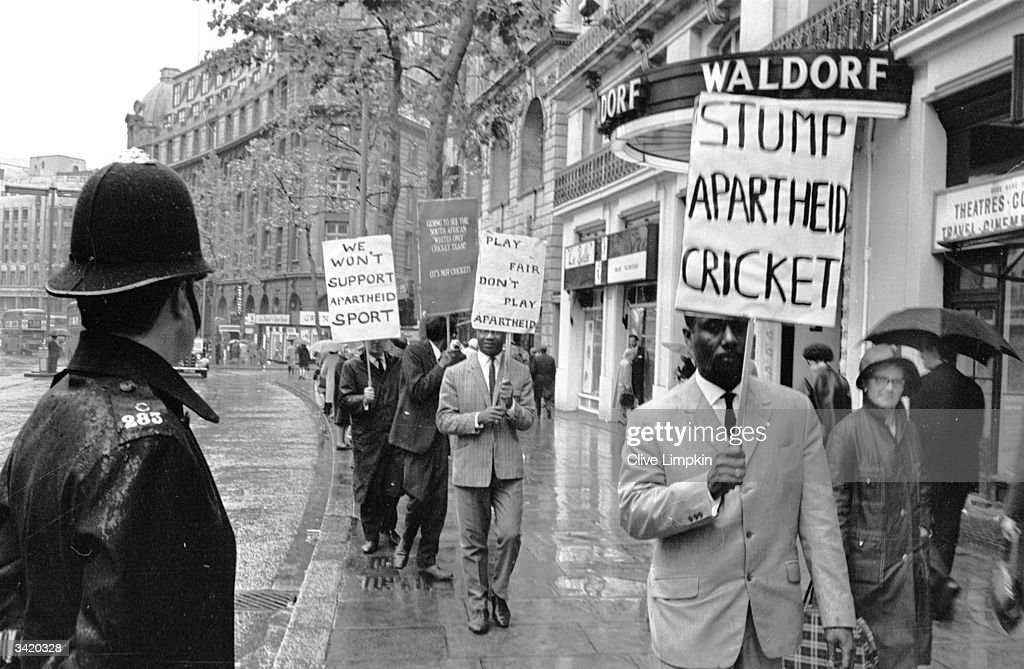 A policeman watching an antiapartheid demonstrators outside the Waldorf Hotel in London where South African cricketers are staying