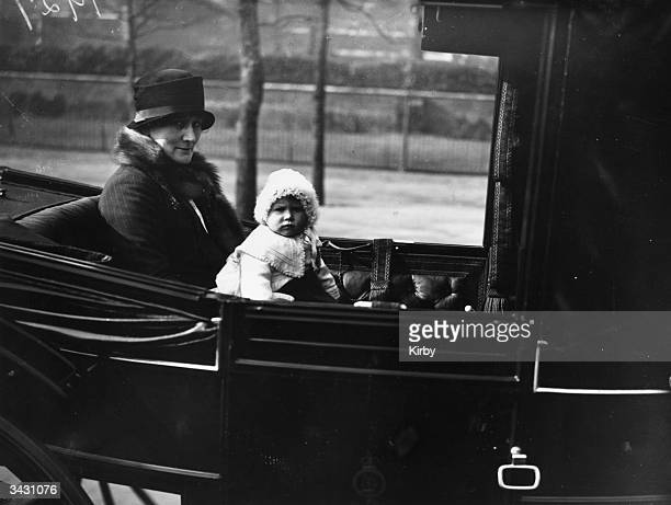Princess Elizabeth baby daughter of King George VI takes a ride in an open carriage