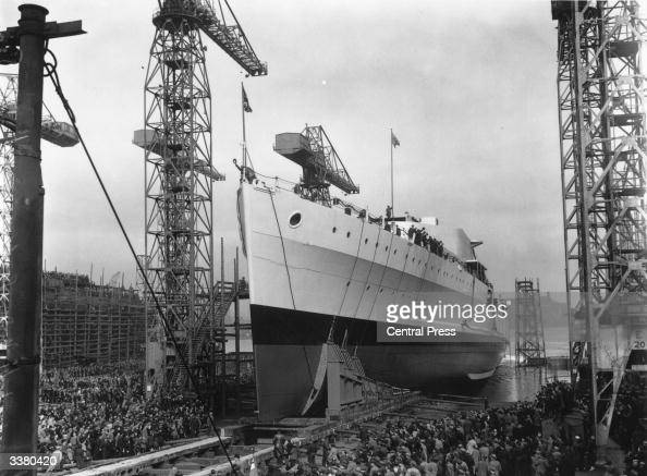 Crowds at the launch of HMS Belfast at the Harland and Wolff shipyard in Belfast
