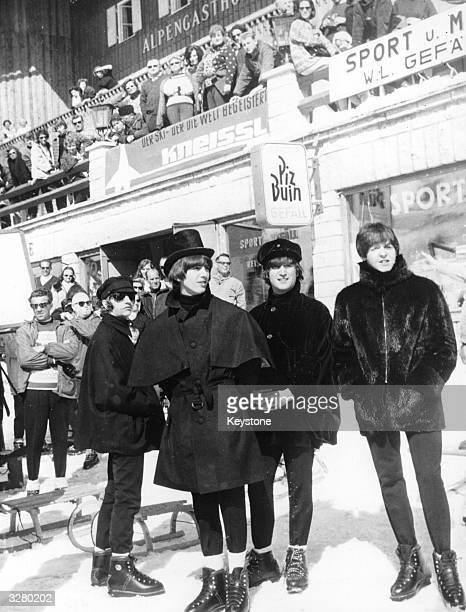 Pop foursome The Beatles in costume and on location for the film 'Help' in Obertauern are watched by holidaymakers