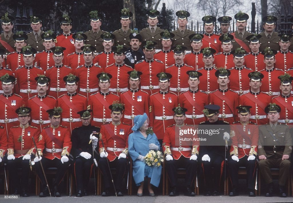 The Queen Mother (1900 - 2002) sharing a joke during the annual ceremony on St Patrick's Day to present the Shamrock to the Irish Guards in London.