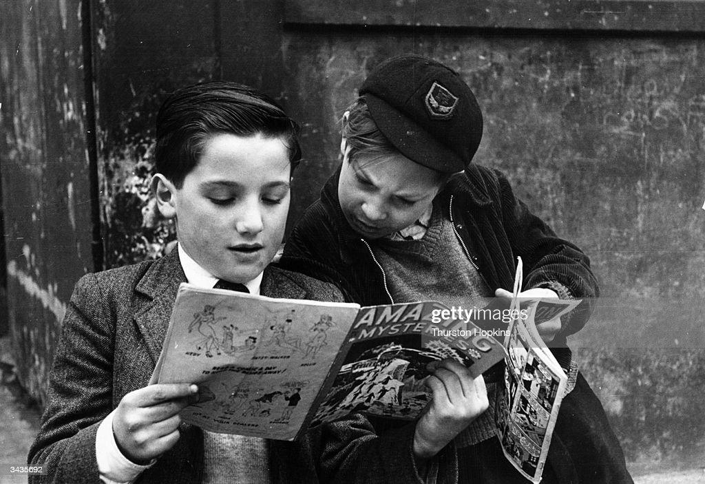 Two young boys reading comics. Original Publication: Picture Post - 5861 - Should US Comics Be Banned? - pub. 1952