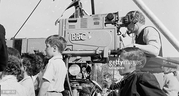 On Hampstead Heath London a camerman for the BBC TV Children's Caravan Tour which takes entertainment to children all over the country films the show...