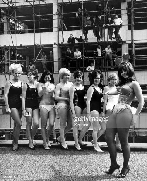 Dolly Read a fully fledged bunny girl at Europe's first Playboy Club about to open in Park Lane poses at the Hilton Hotel London for a group of girls...