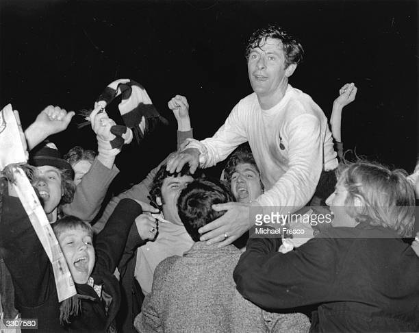 Jubilant Tottenham Hotspur fans carry Alan Mullery around White Hart Lane after Spurs' UEFA Cup win over Wolverhampton Wanderers Mullery scored...