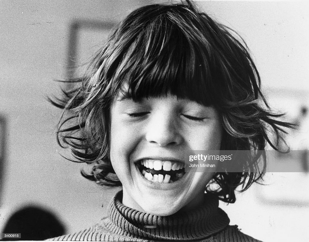A young boy, Christopher Durrance, smiling.