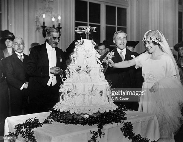 English politician William Wedgwood Benn 1st Viscount Stansgate cutting the wedding cake with his bride Margaret Holmes