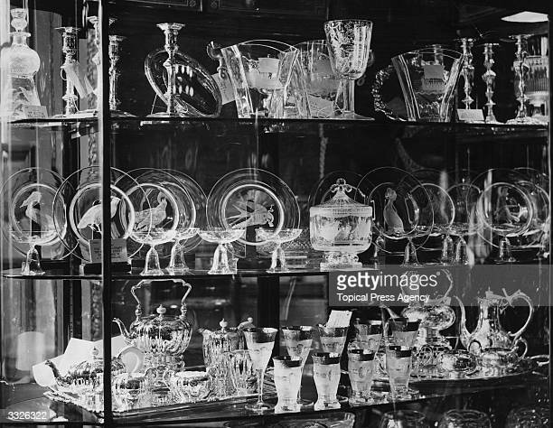 Some of the gifts of glassware given as wedding presents to Princess Elizabeth and Prince Philip on display at St James's Palace London On the top...
