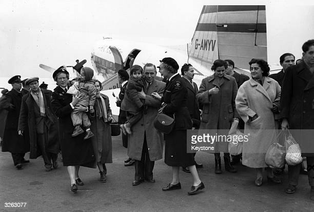 Hungarian refugees are met at Blackbushe Airport by Social Workers