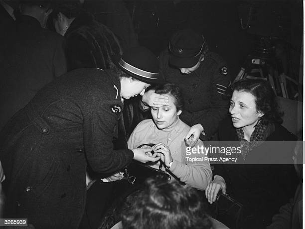 Hungarian refugees arriving at Blackbushe airport in Hampshire receive first aid medical assistance