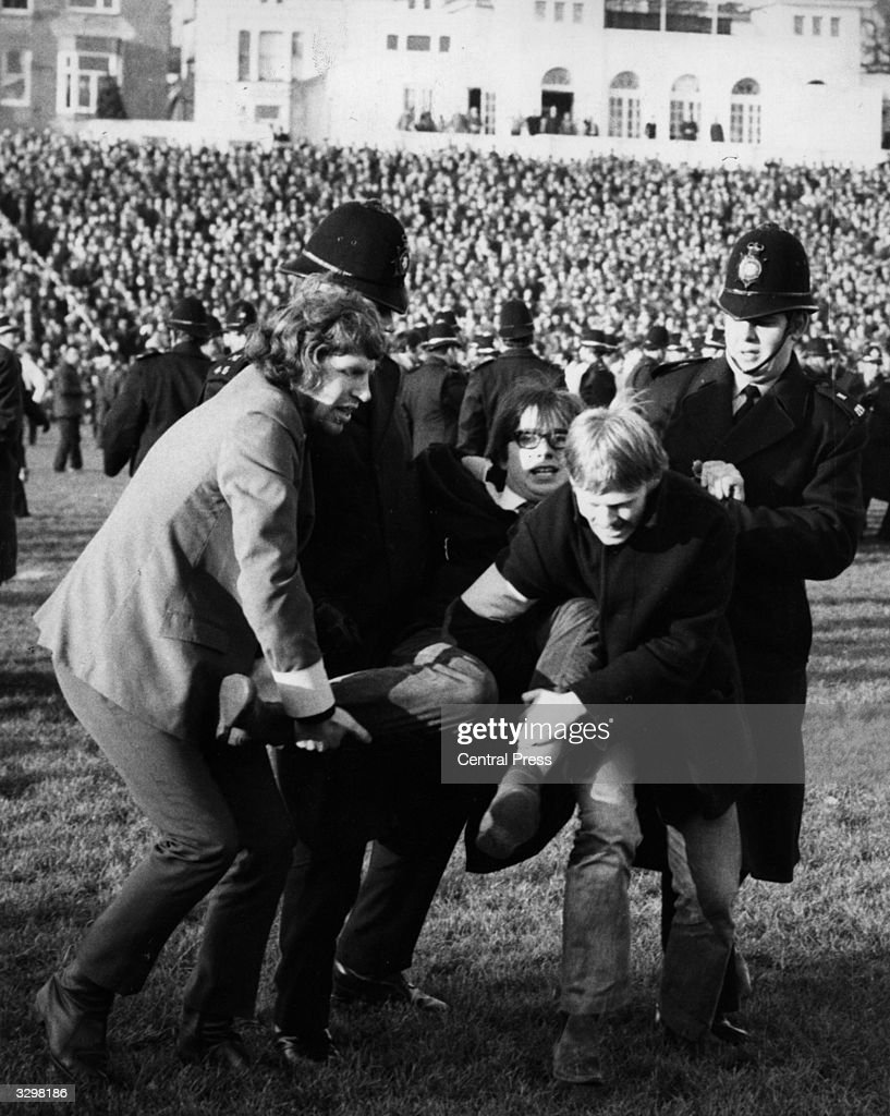 A demonstrator is carried off at antiapartheid protest at Springbok match at Swansea