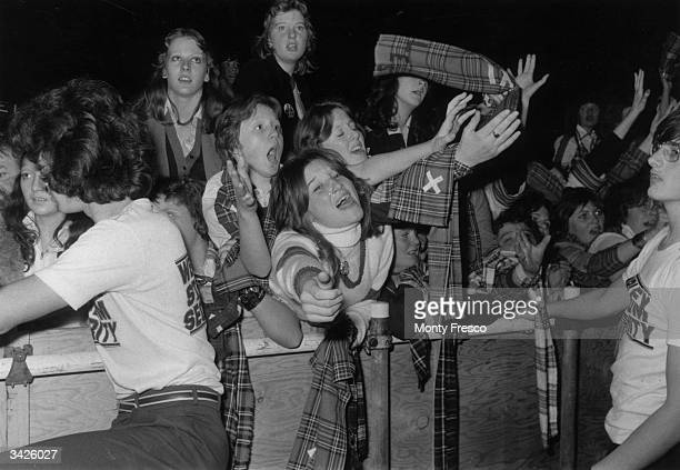 Stewards keep a watchful eye on the hysterical pop fans during a Bay City Rollers concert at Wembey Empire Pool London