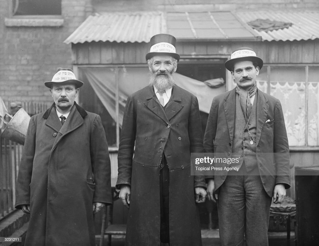Moses Shackman, centre, with members of the Jewish East End Shelter Corps. Their hats are labelled in Yiddish and English.