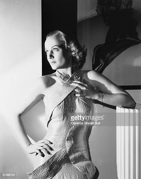 American film actress Carole Lombard wearing a halterneck dress in an unusual style