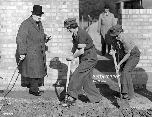 British prime minister Sir Winston Churchill watches women from the Auxiliary Territorial Services women digging the ground